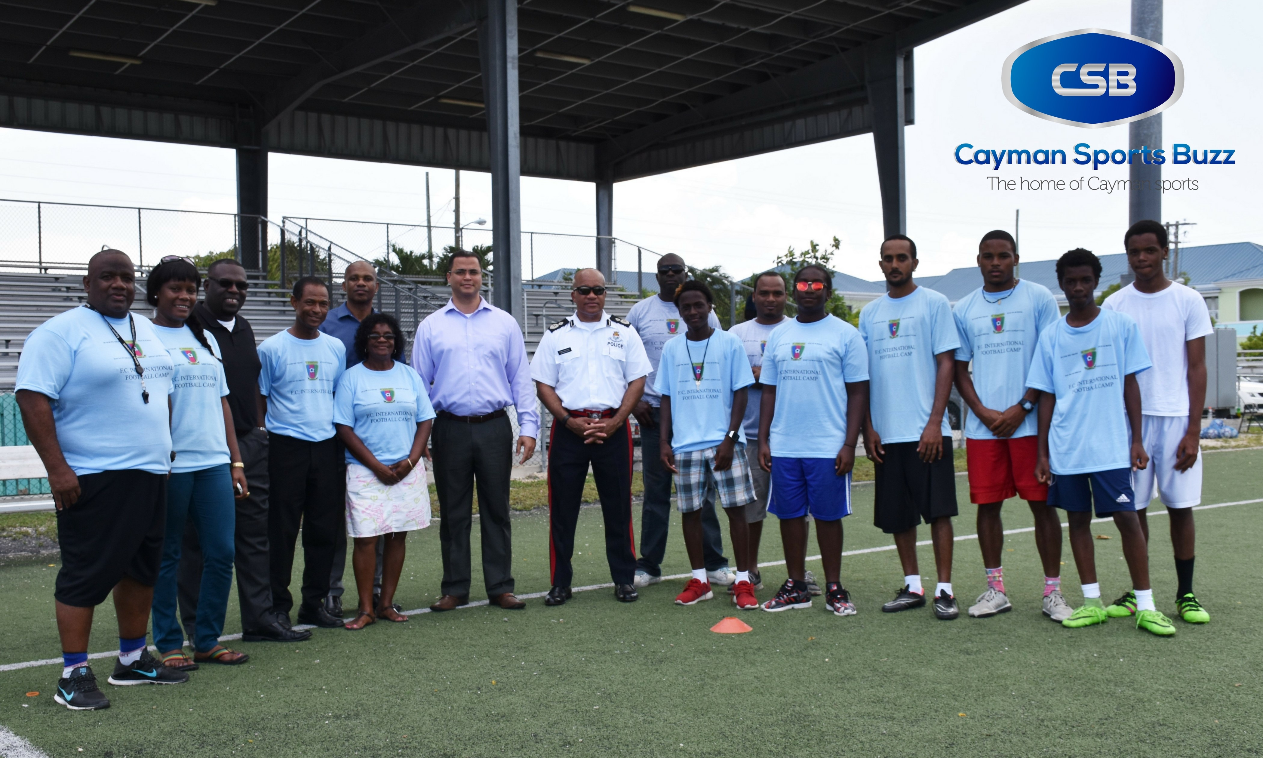 FC International President Kennedy Ebanks (4th from left) with volunteers and guests.