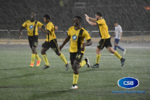 Morrison celebrates his goal amid a downpour.
