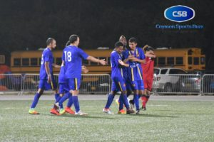 Cayman Brac FC players celebrate after taking the lead.
