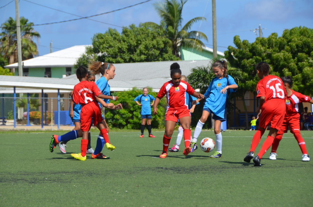 Cayman Prep (blue) defeated Sir John A. Cumber 'B' (red) for third place