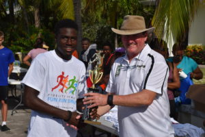 Michael Smikle collects his trophy from Fidelity's Brett Hill.