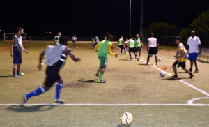 Scholars players participate in drills Thursday night.