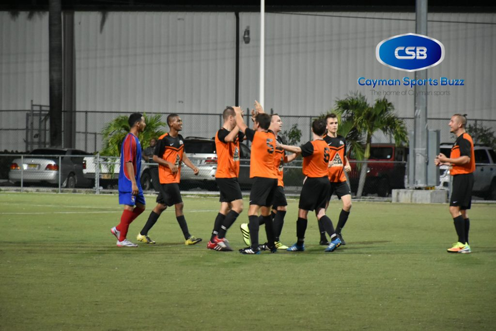 Sunset FC players celebrate their 4th goal of the night.