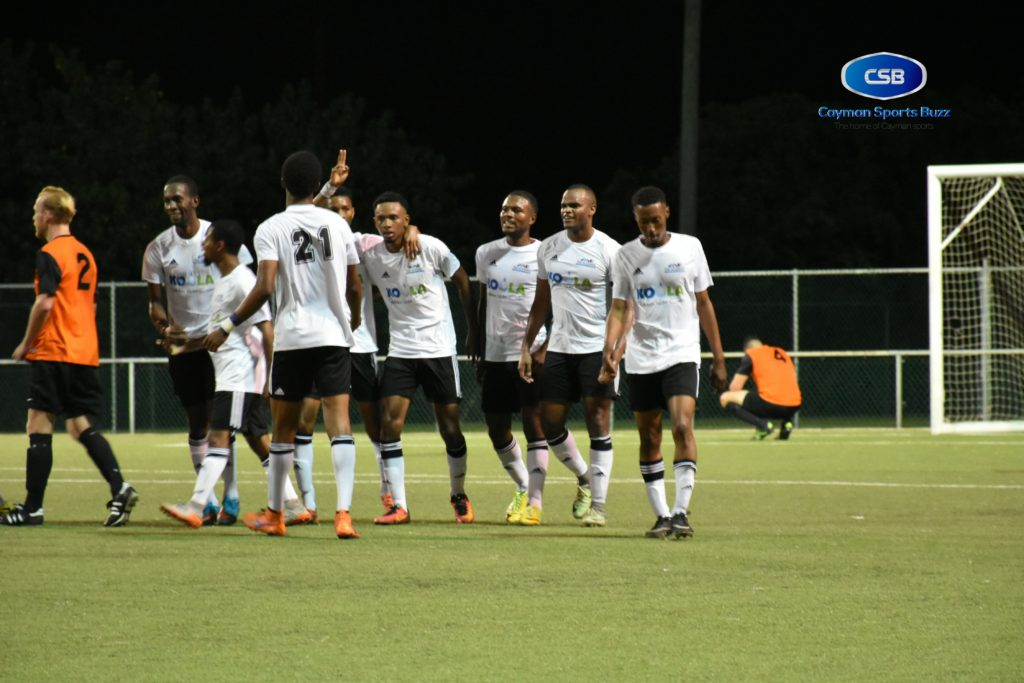 Academy SC players celebrate Jonah Ebanks' second goal.