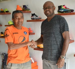 Futbolista World Manager Celso Montoya and Cayman Sports Buzz Editor Ben Meade.