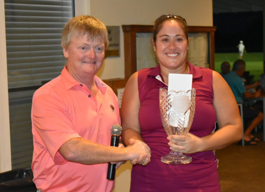 Women's winner Isabel Mendes collects her trophy from CIGA President, Paul Woodhouse.