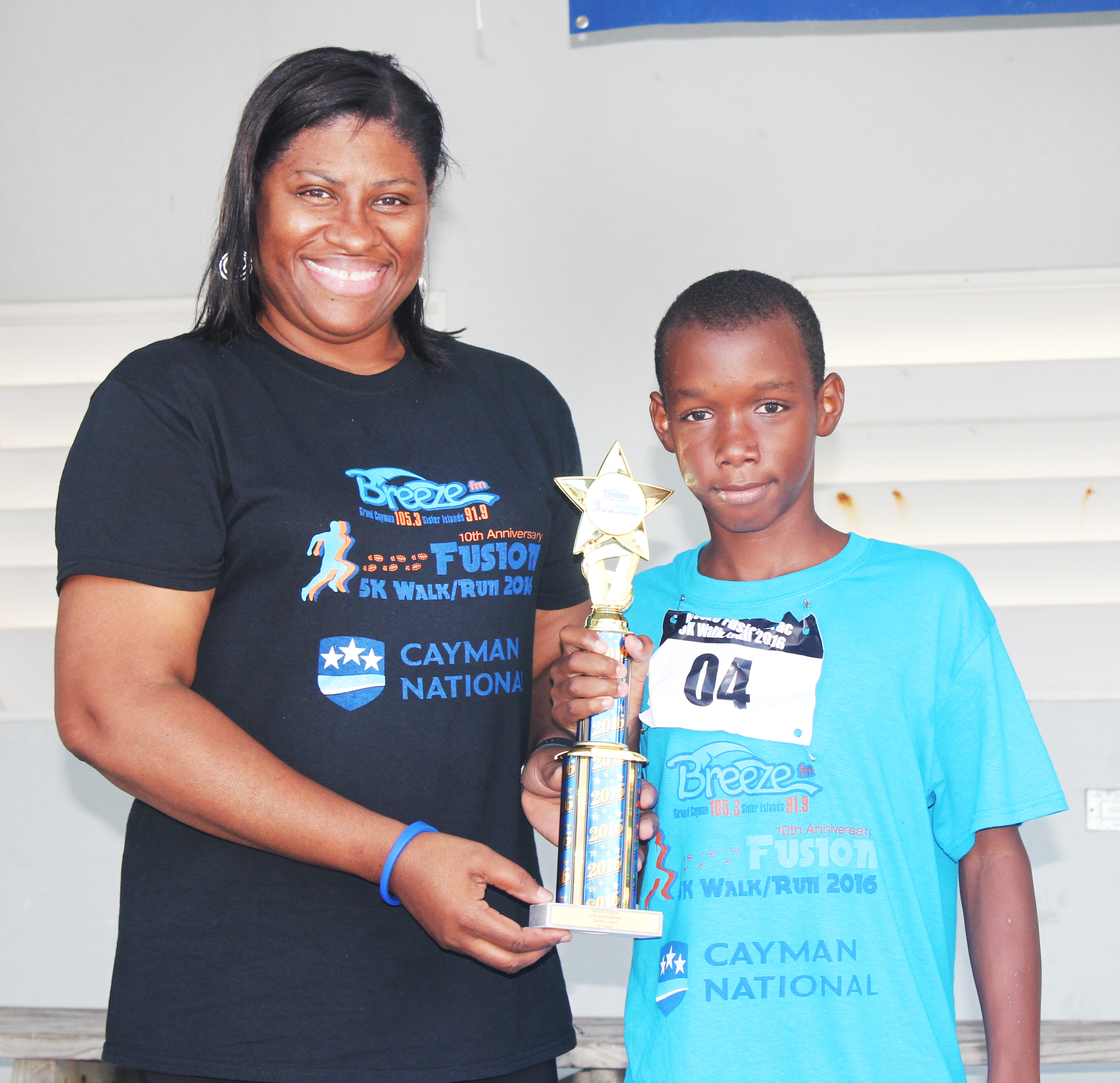 Male Winner Sean Valentine With Radio Cayman Director Norma McField.