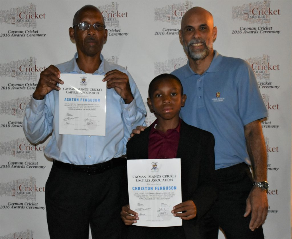 Family Affair: Ashton and Christon Ferguson show off their certificates with former WI captain, Jimmy Adams.