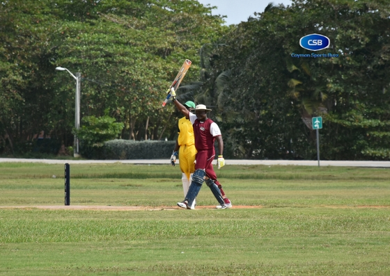In-form opener Jalen Linton raises his bat after reaching his half century for World Stars.